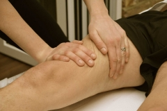 Insight Sports Massage criss cross on quads